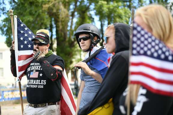Left to right: Robert Montgomery of Pleasanton and Drake Nighswonger from Corona (both men identify as conservative) join a group of approximately 30 conservative demonstrators at Martin Luther King Park in Berkeley California on Thursday, April 27, 2017.
