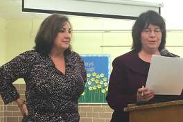 Edwardsville District 7 Board of Education member Dorothy Hummel, left, listens as board president Monica Laurent reads a statement prior to presenting Hummel with a plaque for her eight years of service.