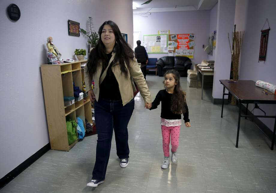 Gisele Loyola escorts her daughter Leticia Pinheiro, 4, inside the Mission Childcare Consortium in San Francisco, Calif. on Thursday, April 27, 2017. With assistance from Mayor Ed Lee and Supervisor Ahsha Safai, Joseph Martinez, the founder and executive director of the childcare center since 1992, was able to secure a down payment to purchase the building from the landlord who was planning a rent increase. Photo: Paul Chinn, The Chronicle