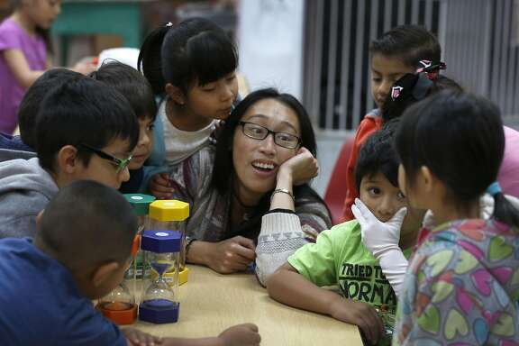Sarah Barbo teaches pre-kindergarten students about hourglasses at the Mission Childcare Consortium in San Francisco, Calif. on Thursday, April 27, 2017. With assistance from Mayor Ed Lee and Supervisor Ahsha Safai, Joseph Martinez, the founder and executive director of the childcare center since 1992, was able to secure a down payment to purchase the building from the landlord who was planning a rent increase.