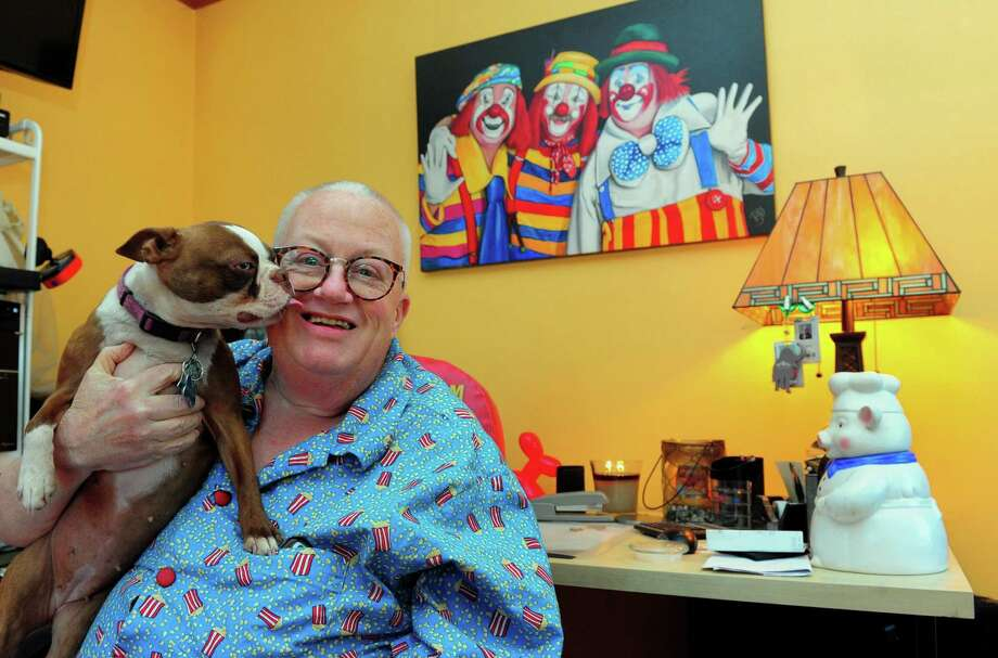 Joe Barney, a clown who once worked for Ringling Bros. and Barnum & Bailey circus, known worldwide at the Greatest Show on Earth, poses with his dog Millie as he shares his memories about the end of the last great circus in America at his home in Bridgeport, Conn., on Tuesday Apr. 18, 2017. Photo: Christian Abraham / Hearst Connecticut Media / Connecticut Post