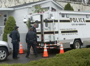 Norwalk police investigate a fatal assault at unit 17 of the mobile home park at 501 Westport Ave. Wednesday, April 26, 2017, in Norwalk, Conn.
