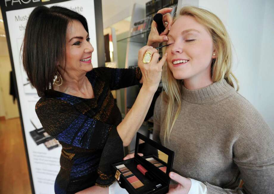 Cosmetics entrepreneur Gail Sagel demonstrates her newest product, Face in a Case, a portable make-up case that doubles as a wallet, on Maggie Walsh, of Westport, at her Faces Beautiful salon in Westport, Conn. on Wednesday, April 26, 2017. Photo: Brian A. Pounds / Hearst Connecticut Media / Connecticut Post