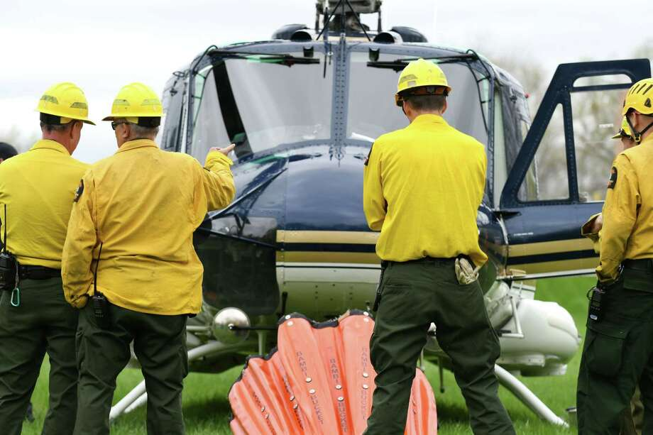Photos: Helicopter water-bucket training in Colonie