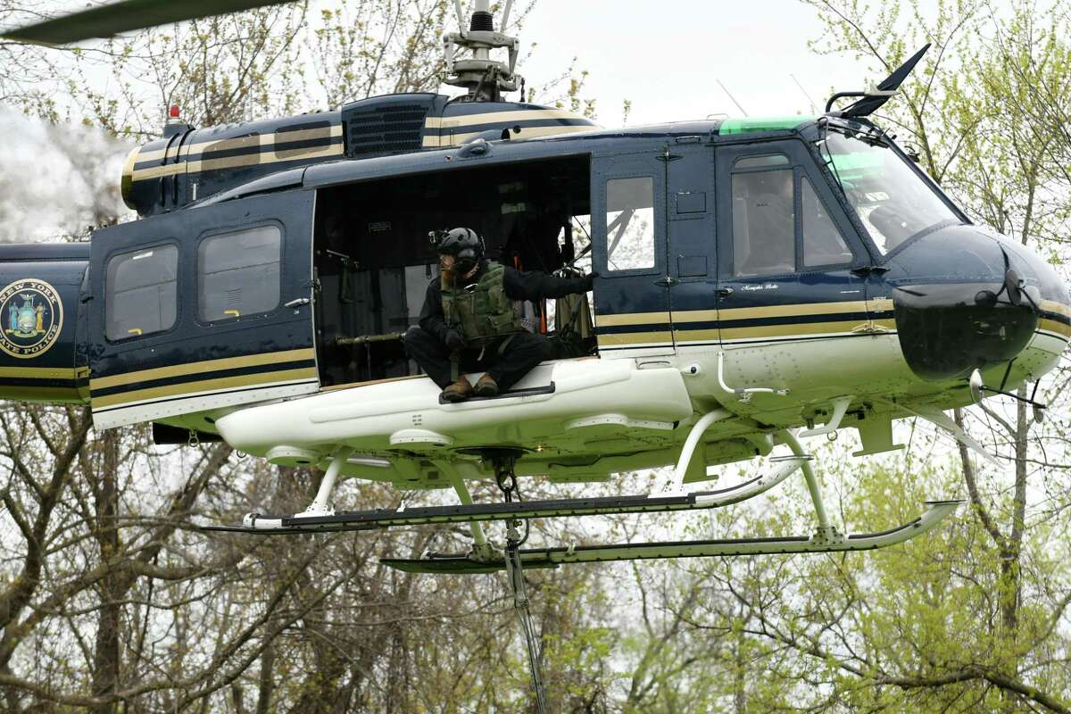 A New York State Police helicopter, like the one pictured here, searched a property in Fort Edward after a rival motorcycle gang got into a fight and then fled into the rural area. (Will Waldron/Times Union)