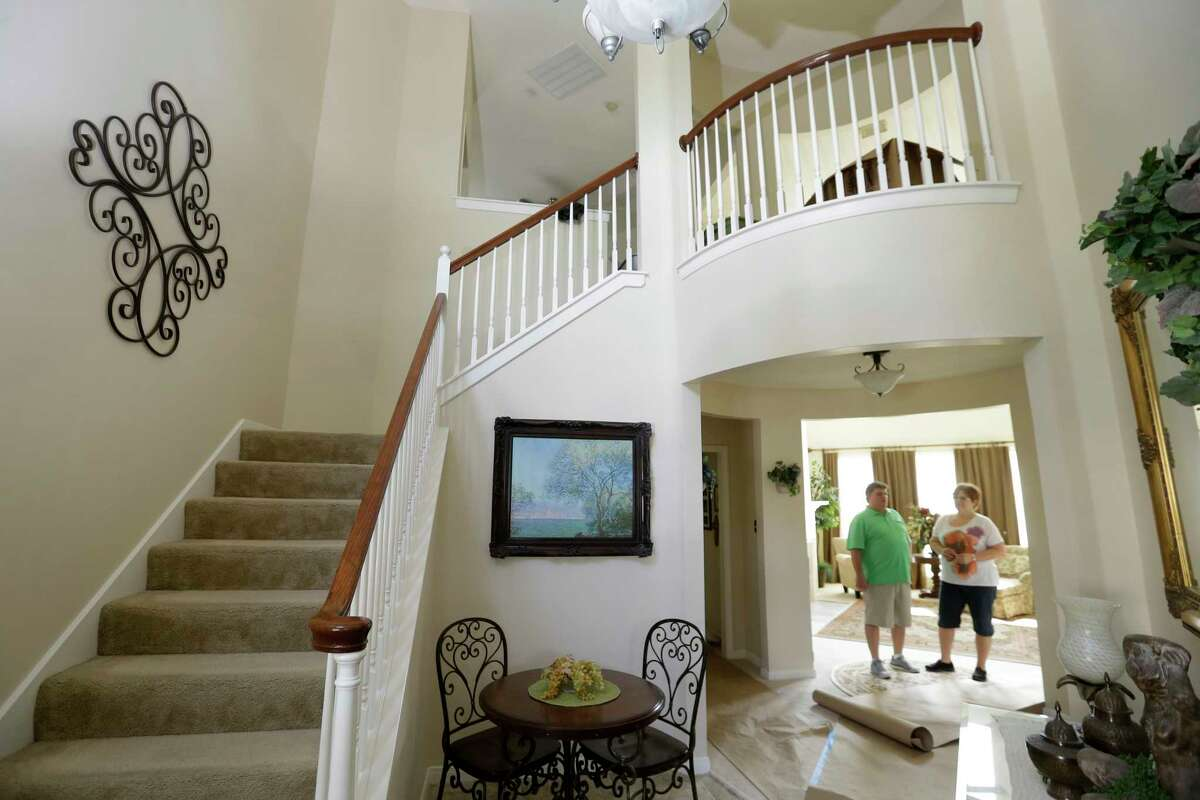Kurt and Mary Jo Shelor talk inside their four-bedroom Cooperfield home that is being prepared to sell shown Thursday, April 20, 2017, in Houston. ( Melissa Phillip / Houston Chronicle )