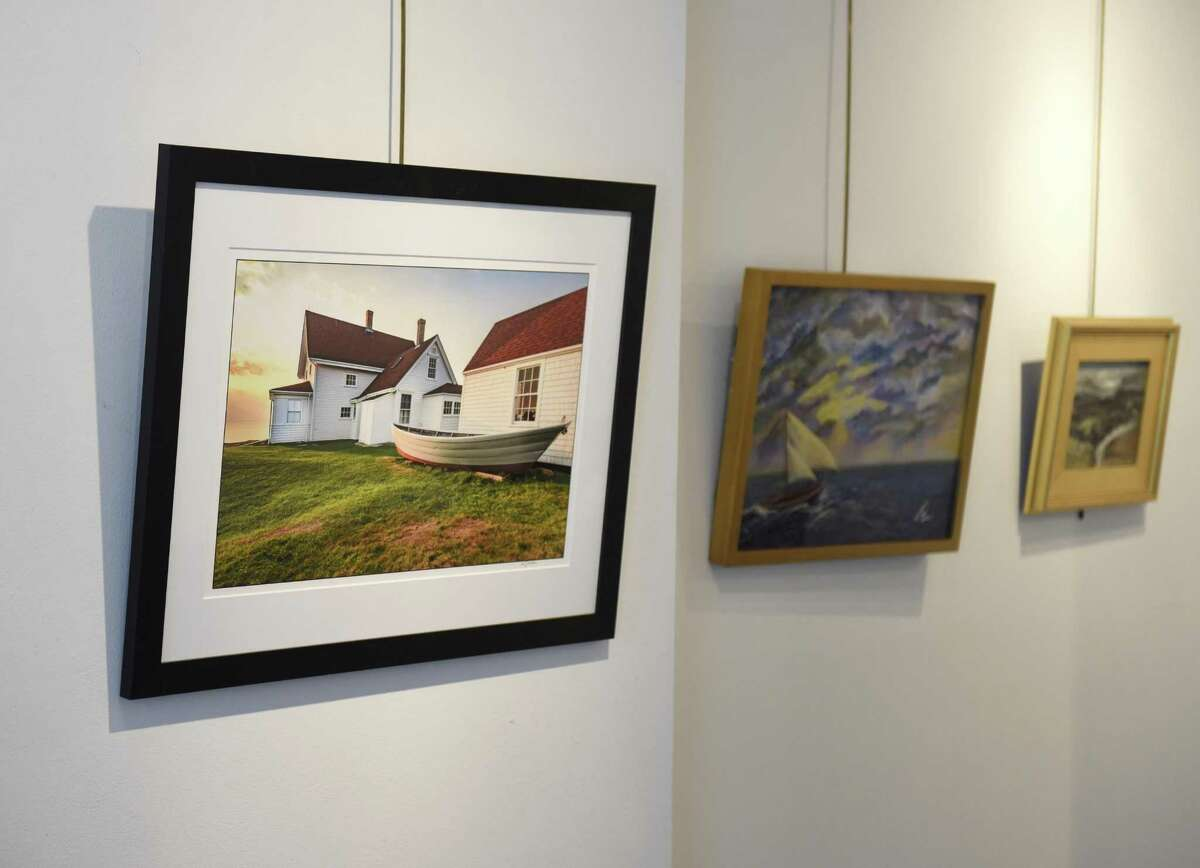 """Bill Gordon's photograph ?""""Marshall Point Sunrise?"""" is displayed among other work in the 18th Annual Vivian & Stanley Reed Marine Show at the Stamford Art Association Townhouse Gallery in Stamford, Conn. Wednesday, April 26, 2017. Artists of many mediums are showing their water-themed work in the show, opening Friday, April 28 at 6 p.m."""