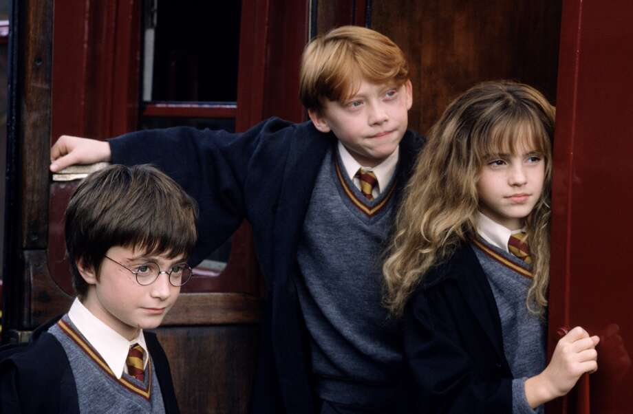 """Daniel Radcliffe, Rupert Grint and Emma Watson in """"Harry Potter and the Sorcerer's Stone."""""""