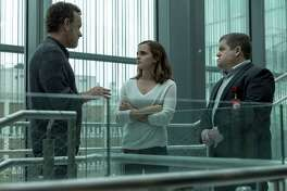 """This image released by STX Entertainment shows Tom Hanks, Emma Watson and Patton Oswalt in a scene from """"The Circle."""" (Francois Duhamel/ STX Financing via AP) ORG XMIT: NYET733"""