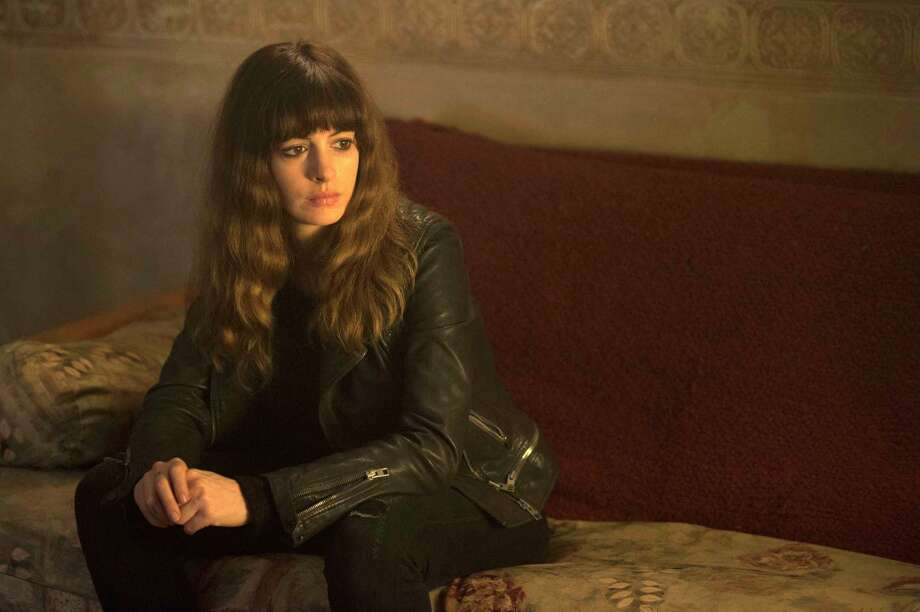 """In this image released by Neon, Anne Hathaway appears in a scene from, """"Colossal."""" (Cate Cameron/Neon via AP) ORG XMIT: NYET718 Photo: Cate Cameron / © 2015 Toyfight Productions, LLC. All Rights Reserved"""