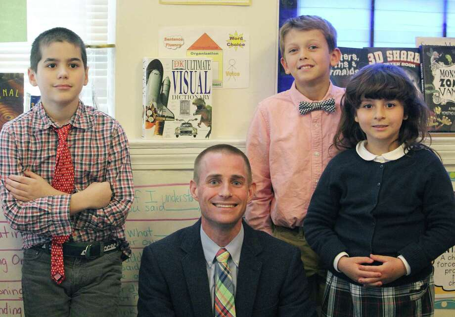 Headmaster Benjamin Powers with students at Eagle Hill Southport School in Southport, Conn. on April 26, 2017. Photo: Laura Weiss / Hearst Connecticut Media / Fairfield Citizen