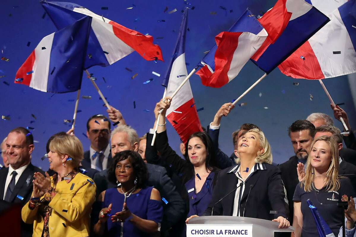 French presidential election candidate for the far-right Front National (FN) party Marine Le Pen (2ndR) is applauded by supporters at the end of a campaign meeting, on April 27, 2017 in Nice. / AFP PHOTO / Valery HACHEVALERY HACHE/AFP/Getty Images