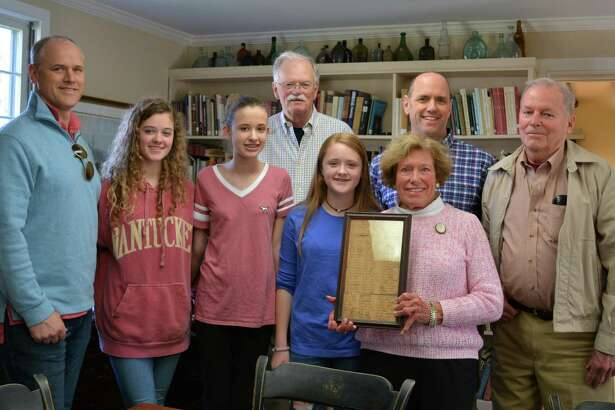 "The Burt family recently donated a Middlesex Militia muster roll from April of 1767, on the occasion of its 250-year anniversary to the Darien Historical Society. Pictured are Jeffrey Burt, Hattie Burt, Chloe Burt, Darien Historical Society historian Ken Reiss, Sophie Burt, Carolyn ""Rusty"" Burt (holding the document), Dave Burt, and Bill Ruscoe."
