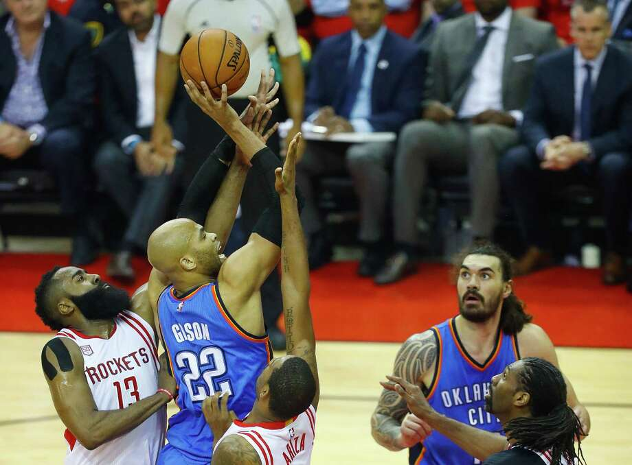 Rockets guard James Harden, left, and forward Trevor Ariza, right, converge on Thunder forward Taj Gibson in Game 5. Rockets coach Mike D'Antoni was pleased with the team's improved performance on defense against the Thunder. Photo: Mark Mulligan, Staff Photographer / 2017 Mark Mulligan / Houston Chronicle