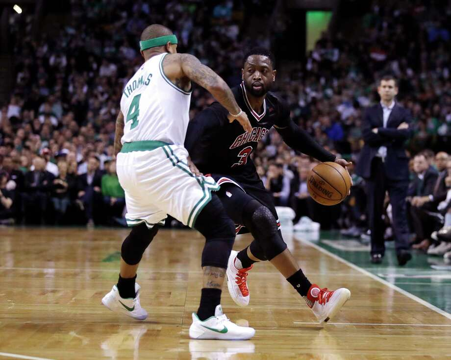 Chicago Bulls guard Dwyane Wade (3) drives to the basket against Boston Celtics guard Isaiah Thomas (4) during the second quarter of a first-round NBA playoff basketball game in Boston, Wednesday, April 26, 2017. (AP Photo/Charles Krupa) Photo: Charles Krupa, Associated Press / AP