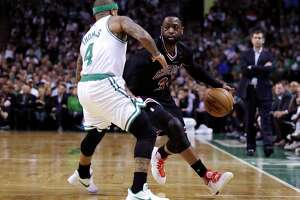 Chicago Bulls guard Dwyane Wade (3) drives to the basket against Boston Celtics guard Isaiah Thomas (4) during the second quarter of a first-round NBA playoff basketball game in Boston, Wednesday, April 26, 2017. (AP Photo/Charles Krupa)