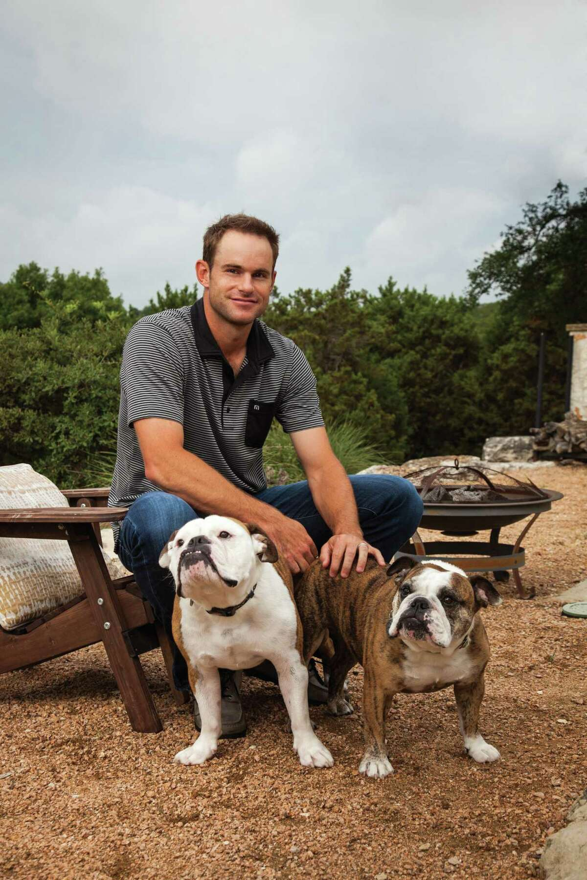 Tennis star Andy Roddick and his dogs, Billie Jean and Bob Costas.
