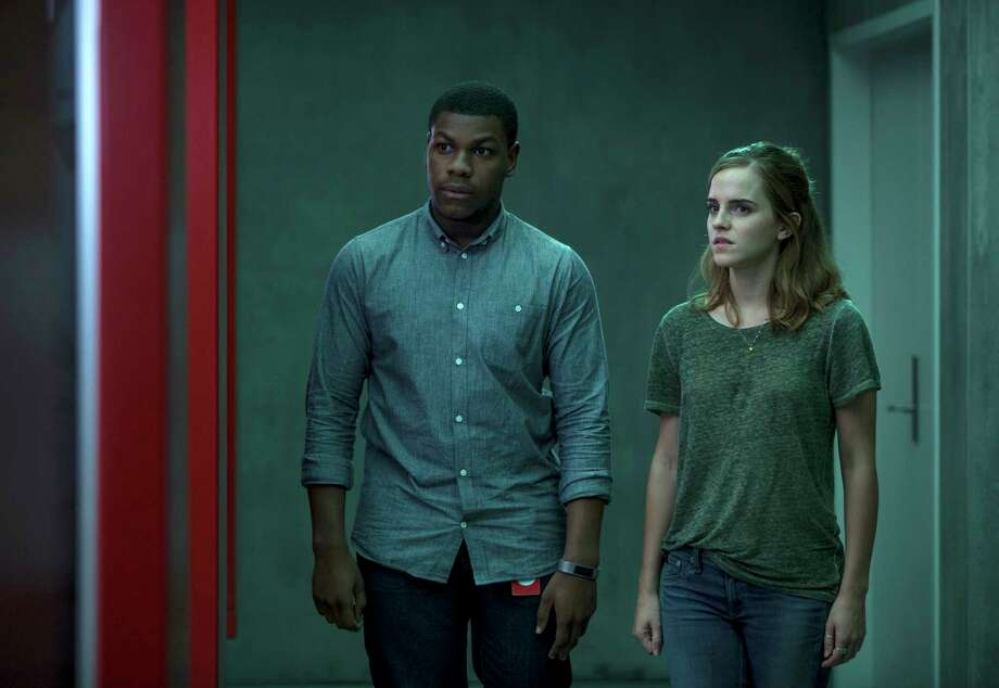 "This image released by STX Entertainment shows John Boyega, left, and Emma Watson in a scene from ""The Circle."" (Frank Masi/ STX Financing via AP) Photo: Frank Masi, HONS / See Change Productions, LLC."
