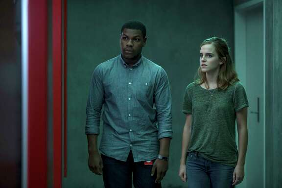"This image released by STX Entertainment shows John Boyega, left, and Emma Watson in a scene from ""The Circle."" (Frank Masi/ STX Financing via AP)"