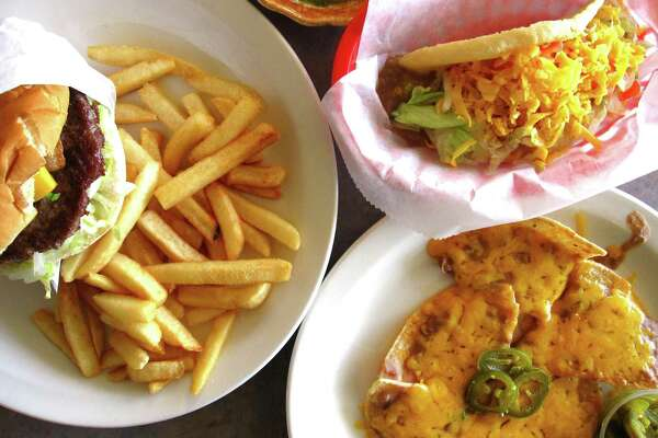 Bacon cheeseburger with fries, left, a bean and cheese puffy taco and a half-order of bean and cheese nachos from Patsy's Place, a new burger and Tex-Mex place on West Avenue started in April by a group of former Ray's Drive Inn employees.
