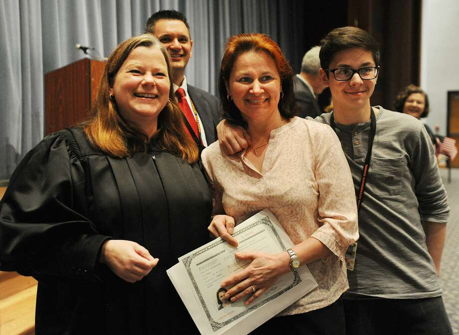 Beata Dobrzycki and her son Alex, of Shelton, pose for a picture with Judge Sarah Merriam after the native of Poland received her U.S. citizenship in a Special Naturalization Ceremony at Shelton Intermediate School in Shelton, Conn. on Thursday, April 27, 2017. Photo: Brian A. Pounds / Hearst Connecticut Media / Connecticut Post