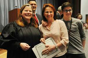 Beata Dobrzycki and her son Alex, of Shelton, pose for a picture with Judge Sarah Merriam after the native of Poland received her U.S. citizenship in a Special Naturalization Ceremony at Shelton Intermediate School in Shelton, Conn. on Thursday, April 27, 2017.