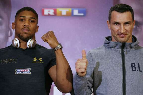 Great Britain's Anthony Joshua (left) poses next to Ukraine's Wladimir Klitschko at Sky broadcasting headquarters in west London on April 27, 2017, ahead of their IBF, IBO and WBA super world heavyweight title fight at Wembley Stadium.