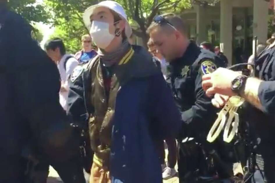 "A protester was placed under arrest for ""obstructing an officer for performing his duties"" at Sproul Plaza at UC Berkeley Thursday."