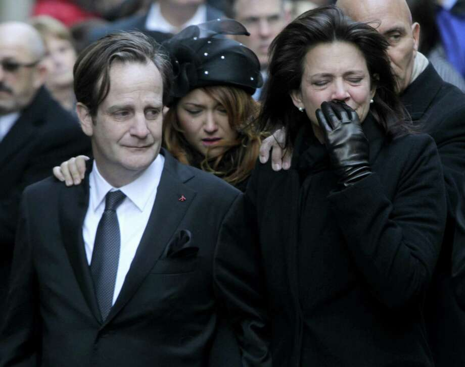 Matthew Badger, left, and ex-wife Madonna Badger, parents of three girls killed along with their maternal grandparents in a Christmas morning fire in Stamford, Conn., react as caskets are carried into a church during a funeral in New York. Photo: File /Associated Press / Copyright 2017 The Associated Press. All rights reserved.