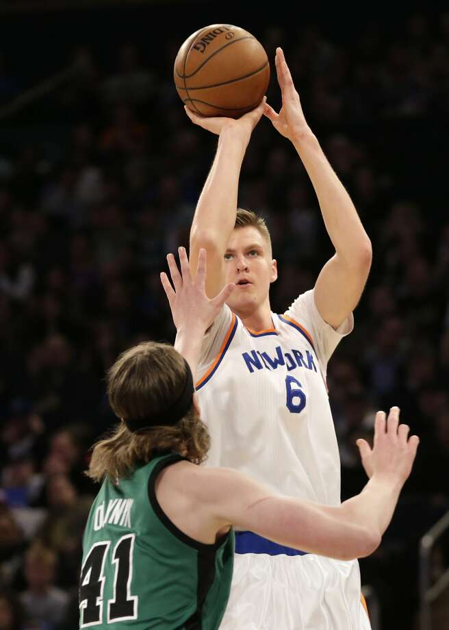 New York Knicks' Kristaps Porzingis, top, shoots over Boston Celtics' Kelly Olynyk during the first half of the NBA basketball game, Sunday, April 2, 2017, in New York. (AP Photo/Seth Wenig) Photo: Seth Wenig, Associated Press