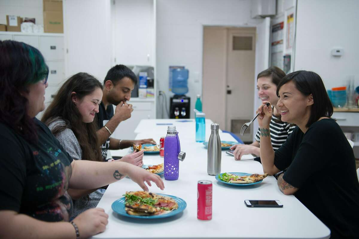 Cat Perez, right, co-founder of health insurance startup HealthSherpa, has lunch with employees at the office in Sacramento, Calif. Thursday, April 27, 2017.