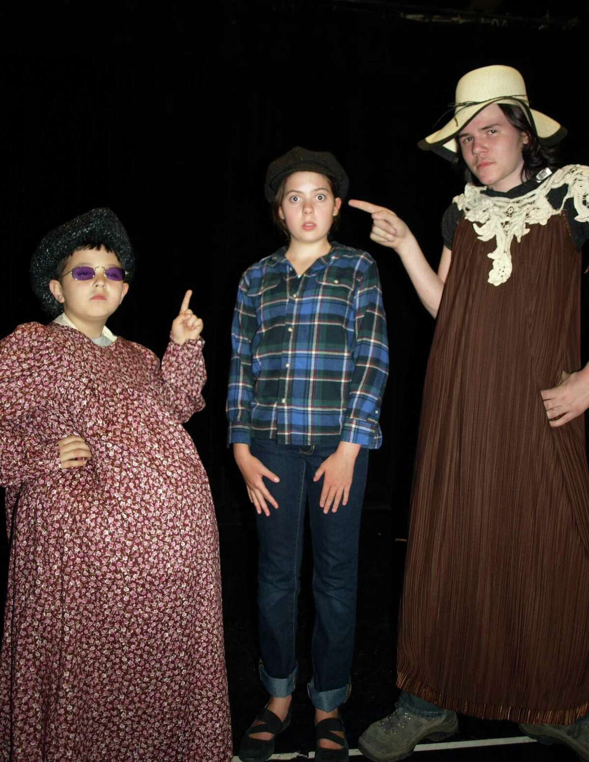 James, center, played by Lilly Tobin, is admonished for failing to week the entire garden by Aunt Sponge (left) Elisha Boguslavskiy, and Aunt Spiker Sam Bemis.