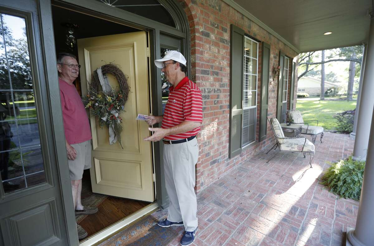 Thomas Hill Adams, one of the mayoral candidates running for the city of Katy, chats with Jerry Martin as he knocked on doors in his neighborhood, Wednesday, April 26, 2017, in Katy.