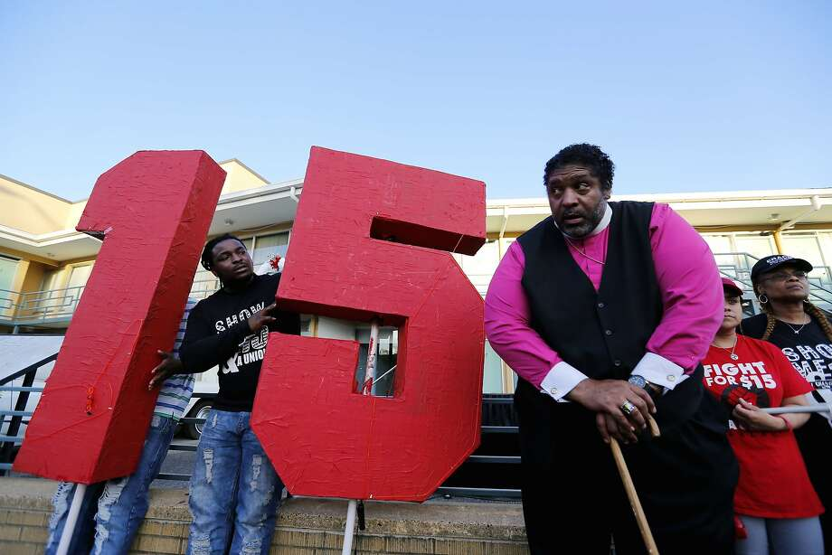 MEMPHIS, TN - APRIL 04:  The Rev. William J. Barber II (R) stands outside the National Civil Rights Museum following a march from City Hall to the museum by Fight for $15 supporters on April 4, 2017 in Memphis, Tennessee. About 1,000 people marched through downtown Memphis from City Hall to the National Civil Rights museum on the 49th anniversary of Dr. Martin Luther King, Jr.'s assassination. (Photo by Mike Brown/Getty Images) Photo: Mike Brown, Getty Images