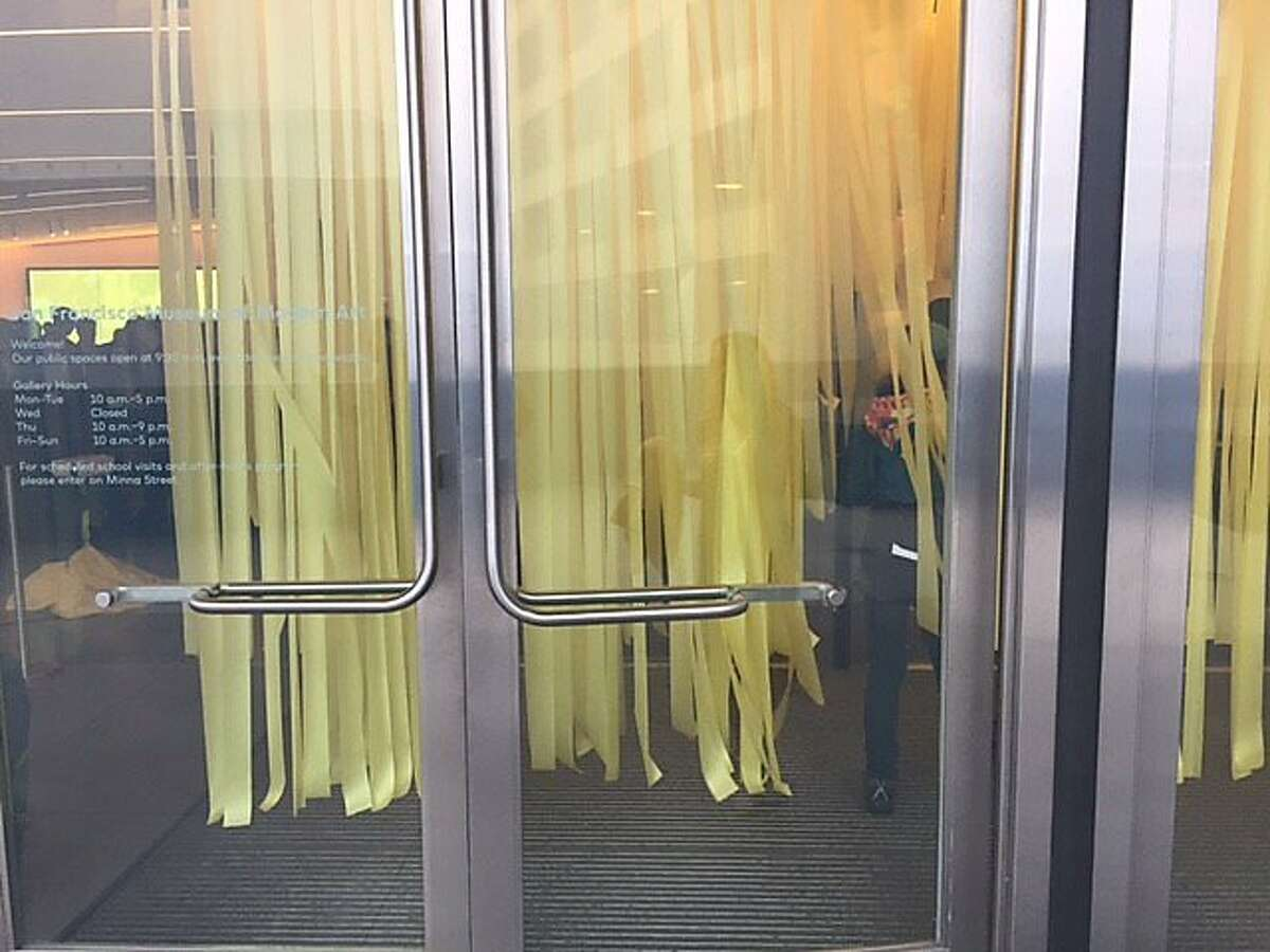 Forest of hanging yellow plastic vines, at SFMOMA