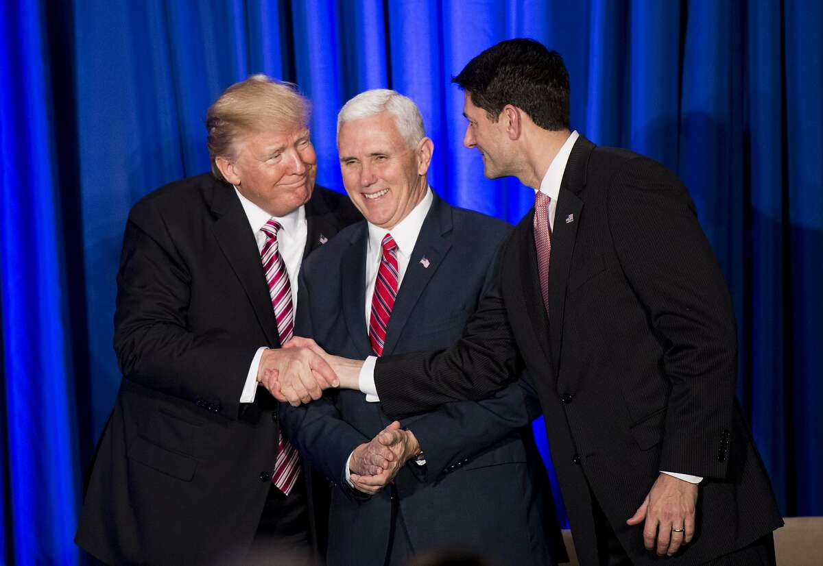PHILADELPHIA, PA - JANUARY 26: U.S. President Donald Trump shakes hands with Speaker of the House Paul Ryan (R-WI) while Vice President Mike Pence (C) looks on during a luncheon at the Congress of Tomorrow Republican Member Retreat January 26, 2017 in Philadelphia, Pennsylvania. Congressional Republicans are gathering for three days to plan their 2017 legislative agenda. (Photo by Bill Clark-Pool/Getty Images) *** BESTPIX ***