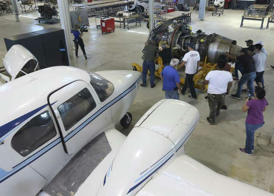 Faculty, students and staff help move a $7 million turbo fan jet engine, donated by Southwest Airlines, shortly after its arrival May 26, 2017 at the St. Philips College Southwest campus. The engine, now the largest engine in the college's aviation technology program, came off one of the airline's 737 airplanes after it had reached its service life. Photo: William Luther, Staff / San Antonio Express-News / © 2017 San Antonio Express-News