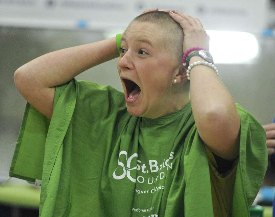 Shepaug Valley School senior Madeline Gorra reacts as she feels her shaved head for the first time. Gorra was challenged by her math teacher and soccer coach, Tara Flaherty, to raise $10,000 dollars for cancer research, if she accomplished her goal Flaherty said would shave her head. Flaherty and Gorra, as well as others, shaved their heads on Thursday, April 27, 2017, in Washington, Conn. Photo: H John Voorhees III / Hearst Connecticut Media / The News-Times