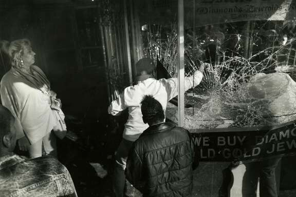 Looters making their way down Market St., breaking windows of a jewelry story and taking whatever they can get their hands on. 5/1/1992