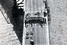 Bay Bridge closure, by protesters over Rodney King decision. The incline section, CHP arrest people who blocked the bridge. May 1, 1992.