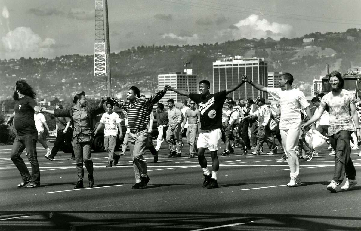 A line of Berkeley students lead the protesters against traffic on I-80 heading toward the toll plaza in this file photo from May 1, 1992.