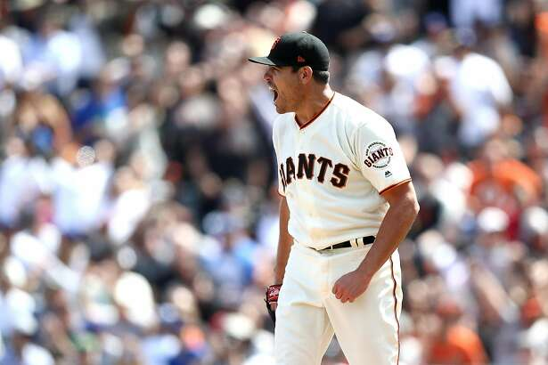 SAN FRANCISCO, CA - APRIL 27:  Matt Moore #45 of the San Francisco Giants reacts after he struck up Cody Bellinger #35 of the Los Angeles Dodgers to end the seventh inning at AT&T Park on April 27, 2017 in San Francisco, California.  (Photo by Ezra Shaw/Getty Images)