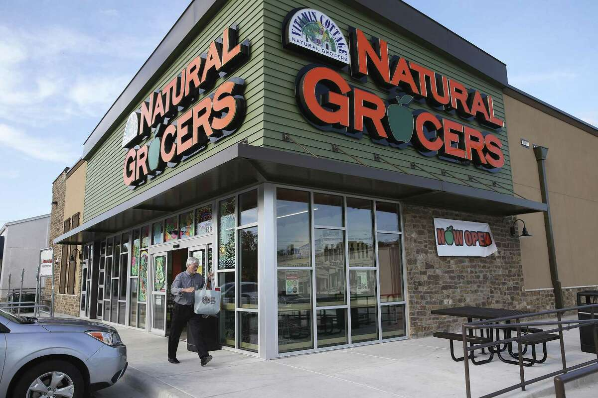 Kelly Ranson heads home with purchases at the new Natural Grocers store at 6514 N. New Braunfels Ave.