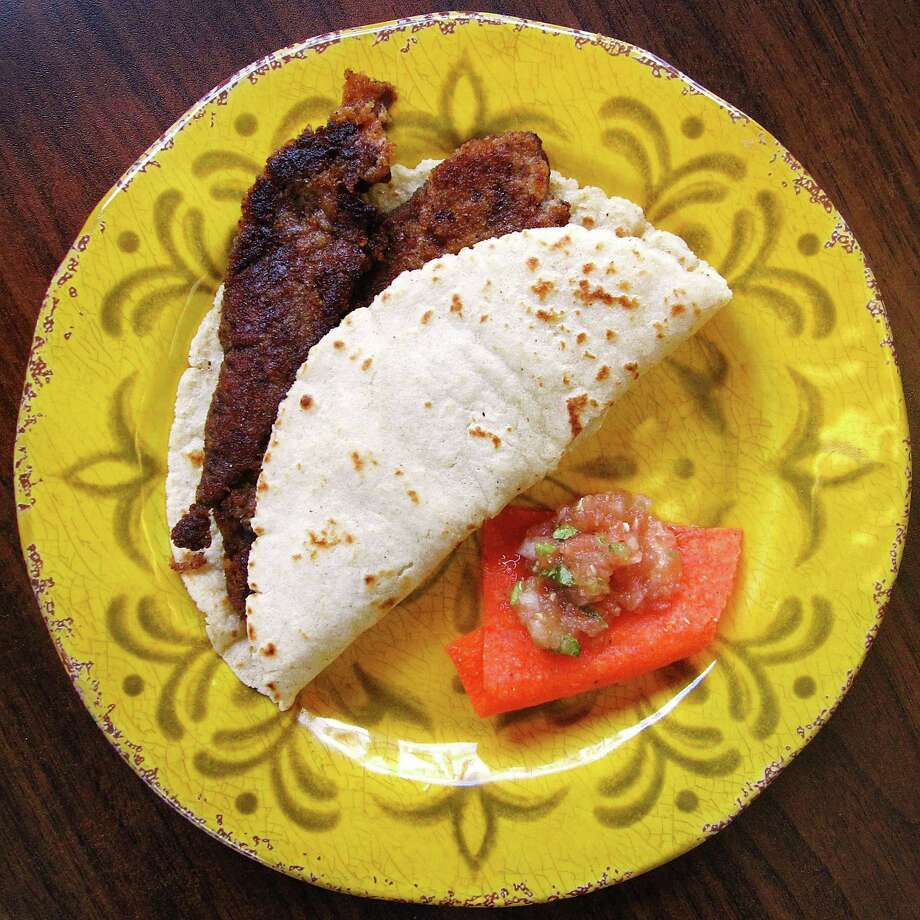 Milanesa taco on a handmade corn tortilla from Torresitas Mexican Restaurant on Culebra Road. Photo: Mike Sutter /San Antonio Express-News