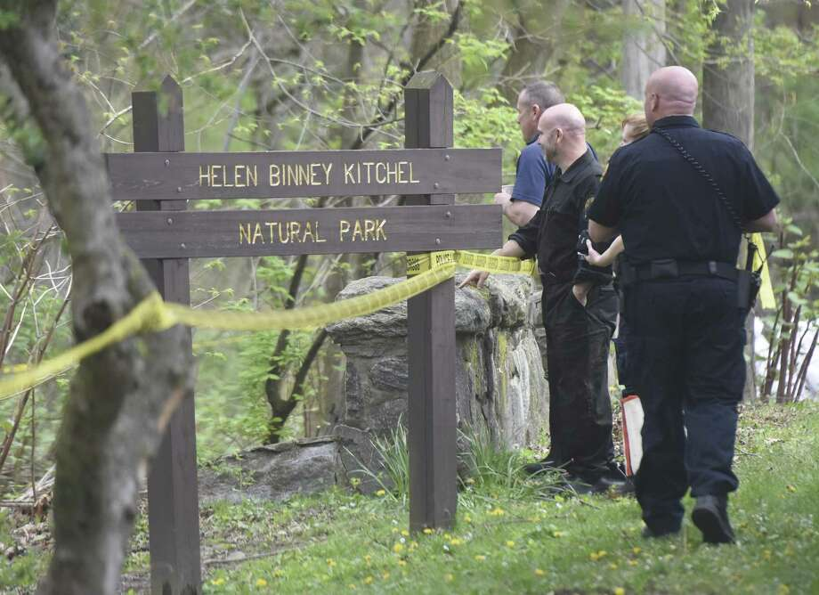 Local and state authorities expand their investigation from Wednesday of the scene in which human remains were found in Helen Binney Kitchel Natural Park in Old Greenwich, Conn. Thursday, April 27, 2017. Town employees clearing debris found human remains Wednesday and the area remained taped off as canvassing of the scene continued Thursday. Photo: Tyler Sizemore / Hearst Connecticut Media / Greenwich Time