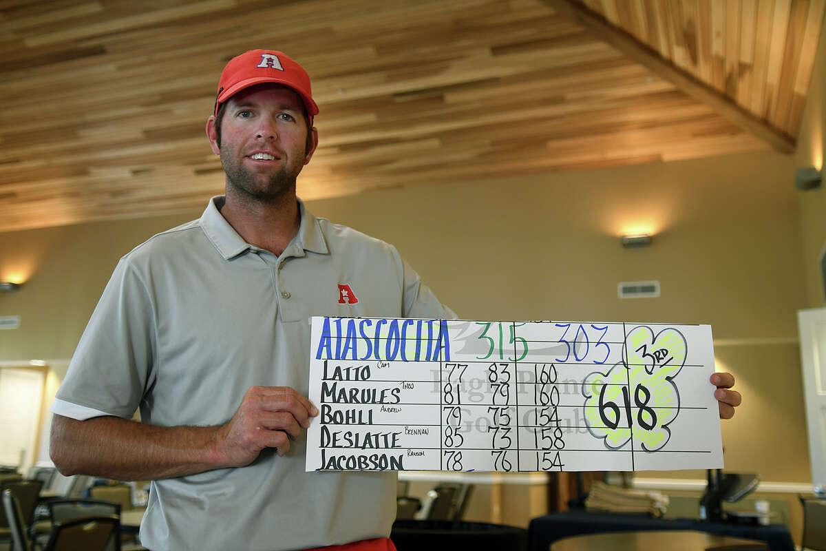 Atascocita Head Boys Golf Coach Scott Bryant proudly shows off his team's scores after the medal ceremony at the Region III-6A Boys Golf Championships at Eagle Pointe Golf Club in Mont Belvieu on Thursday, April 27, 2017. (Photo by Jerry Baker/Freelance)