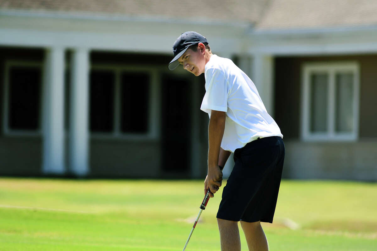 Kingwood freshman Damin Strydom follows his putt on the par 4 16th hole during the Region III-6A Boys Golf Championships at Eagle Pointe Golf Club in Mont Belvieu on Thursday, April 27, 2017. (Photo by Jerry Baker/Freelance)
