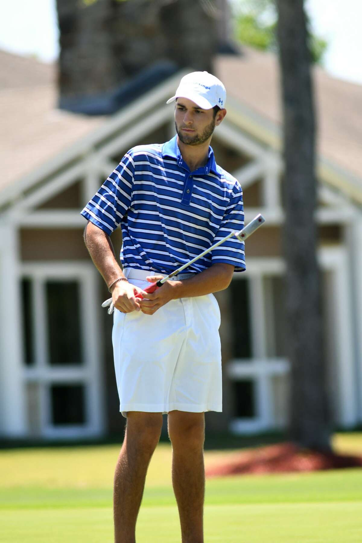 Clear Springs sophomore Niko Nebout follows his putt on the par 4 16th hole during the Region III-6A Boys Golf Championships at Eagle Pointe Golf Club in Mont Belvieu on Thursday, April 27, 2017. (Photo by Jerry Baker/Freelance)