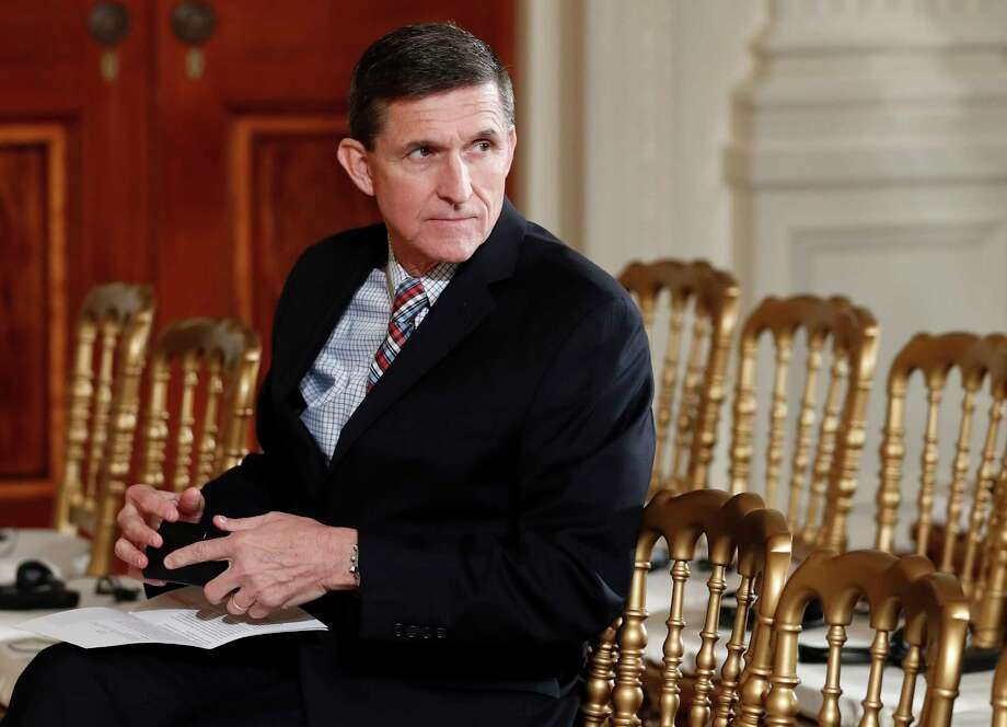 """In this Feb. 10, 2017, file photo, then-National Security Adviser Michael Flynn sits in the East Room of the White House in Washington. He resigned Feb. 13, 2017, just 24 days into the job. Documents released by lawmakers show Flynn was warned when he retired from the military in 2014 not to take foreign money without """"advance approval"""" by Pentagon authorities.Click through the gallery to see President Donald Trump's cabinet appointments: Photo: Carolyn Kaster, STF / Copyright 2017 The Associated Press. All rights reserved."""