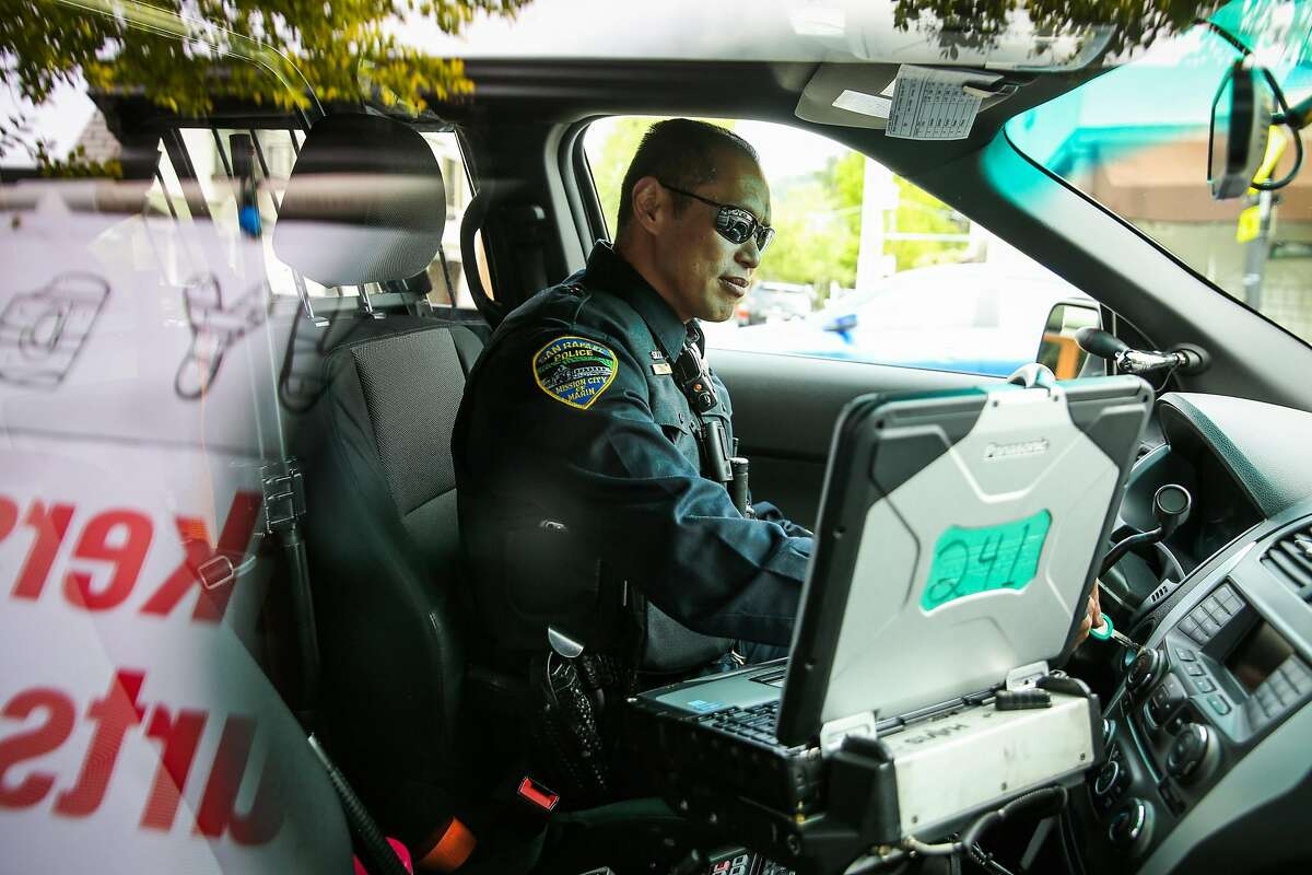San Rafael Police officer Ed Chiu gets in the car after making a stop while out on patrol in San Rafael, California, on Monday, April 24, 2017.